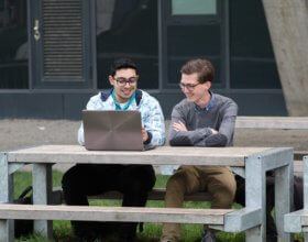Ali Kahawati's mentor, Casper Kroes, right, helps him work on his Dutch language skills. (Photo by Sahar Jahish,  UAF)