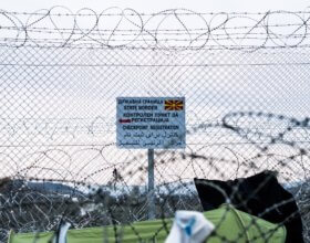 A fence on the border between Greece and Macedonia, where a makeshift refugee camp is struggling to handle the estimated 14,000 people stranded here after Macedonia announced it would close the border. Photo by: Valerie Plesch