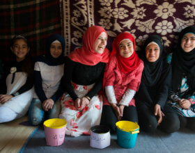Syrian refugee girls gather in a settlement in Lebanon (Photo: Unicef).