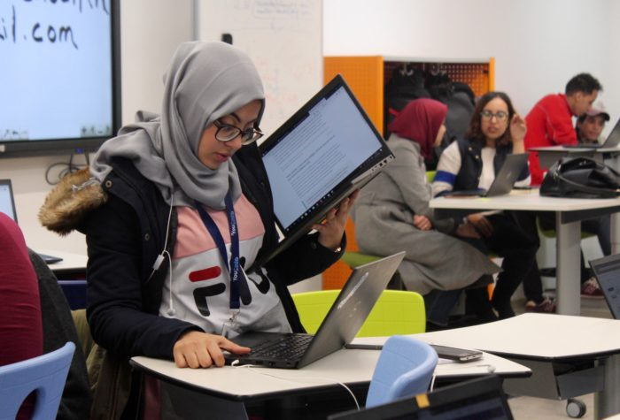 Hind Lebbane, a YouCode learner, checks her work during an afternoon workshop at YouCode. (Photo: Megan O'Herron)