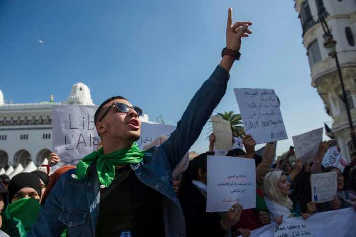 Algerian university students a day after President Abdelaziz Bouteflika announced that he was withdrawing his candidacy for a new term (Photo:  Louiza Ammi, AP Images).