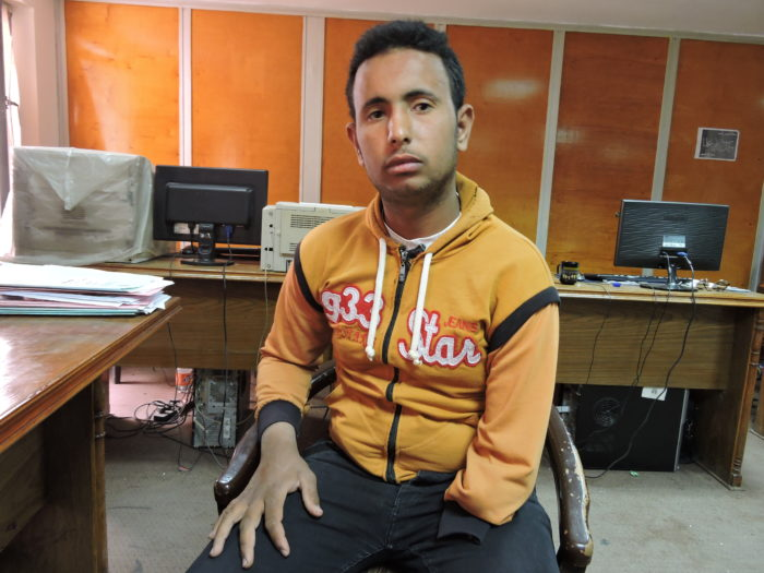 Ahmad Ashraf's hand was severed by a machine at the cotton gin where he worked in Alexandria. He did not have health insurance and lost his job after the accident (Photo:Tarek Abd El-Galil).
