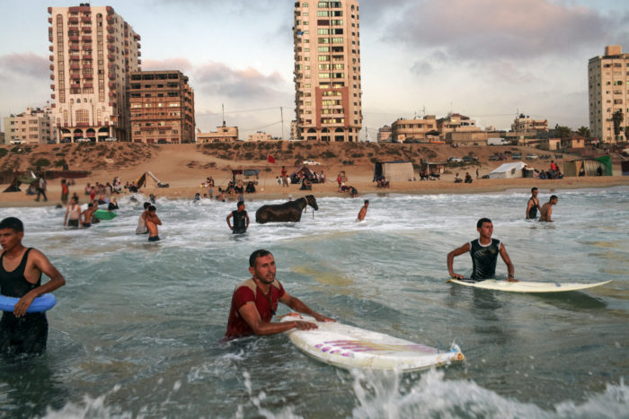 During the summer months the beaches around Gaza City attract large crowds, with the coast being the only real recreational space available in Gaza. From The starkly named Gaza.