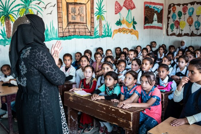 Girls sit in a crowded classroom at a school near Mosul. Iraq faces a severe shortage of teachers and needs more school buildings, advocates say (Photo: Tom Peyre-Costa/NRC).