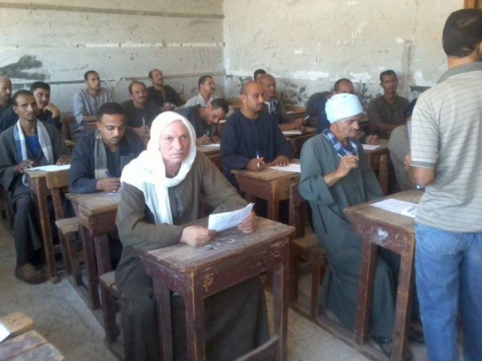 Men sit for an adult literacy test in Assiut Governorate, in southern Egypt. Low literacy rates are a challenge for adult learning efforts in many Arab countries (Photo: General Authority for Literacy and Adult Education).