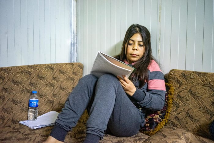 Zahra studying at home. She hopes to win a scholarship to pursue a master's degree abroad (Photo:  Olivia Cuthbert).