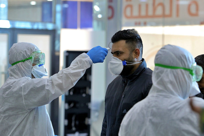 Iraqi medical staff checking passengers arriving from Iran in the Najaf airport. Iraq's long border with Iran and close cultural relations are now putting it at risk for Covid-019 infections (Photo: Anmar Khalil/AP).