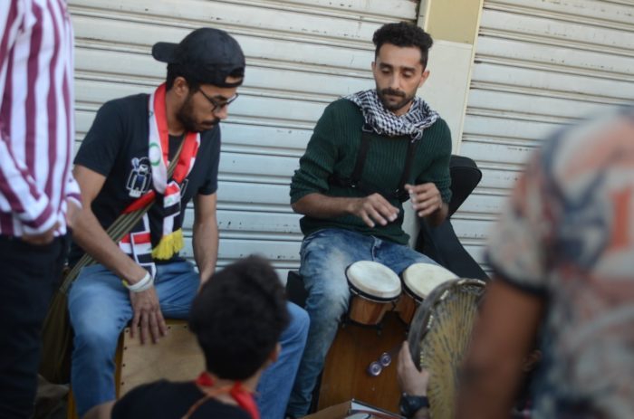 Street musicians perform for the protesters in Baghdad (Photo: Caesar Al-Wardi).