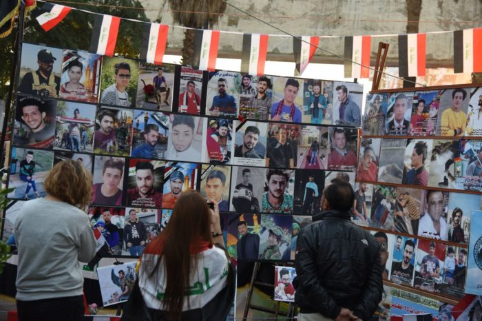 A memorial under the Liberation Monument honors some of the hundreds of protesters who have been killed in violent crackdowns on the demonstrations (Photo: Caesar Al-Wardi).