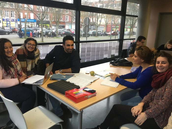 Camille Doré, (front right) founder and director of Pangea, a group that supports refugee students, in discussion with the group's members (Photo: Courtesy of Pangea).