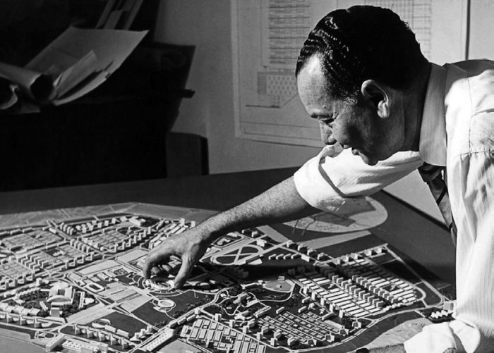 The architect Sayed Karim stands over a scale model of Nasr City, his plan for an urban expansion of Cairo in the 1950s (Photo: Private collection).