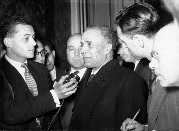 Habib Bourguiba, the first president of Tunisia, shown here being interviewed in Paris in 1955, increased education funding to nearly 36 percent of the nation's budget by the early 1970s (Photo: Alamy/Keystone Pictures).
