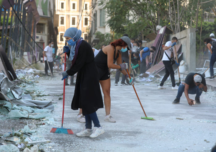 Volunteers clean a street following Tuesday's blast in Beirut (Photo: Mohamed Azakir/Reuters).