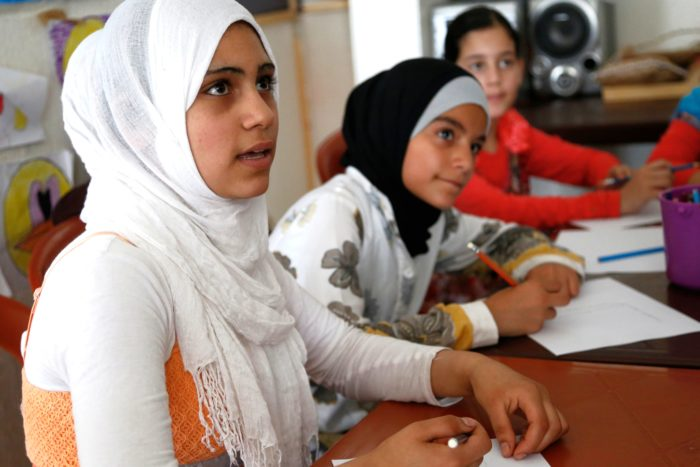 Syrian girls at a discussion about early marriage and children's rights in Lebanon in an effort supported by multiple nongovernmental organizations (Photo courtesy of Russell Watkins/Department for International Development).