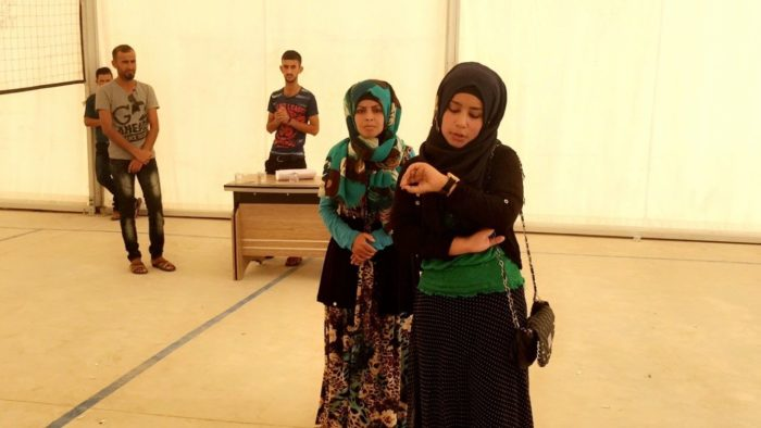 Actors perform a skit for displaced people at the Daquq Camp in Kirkuk, Iraq. Nearly half of school-age internally displaced children in Iraq are out of school, and one-third of all Syrian refugee children are. (Photo: Mahmoud Al-Najjar/ARA Network).