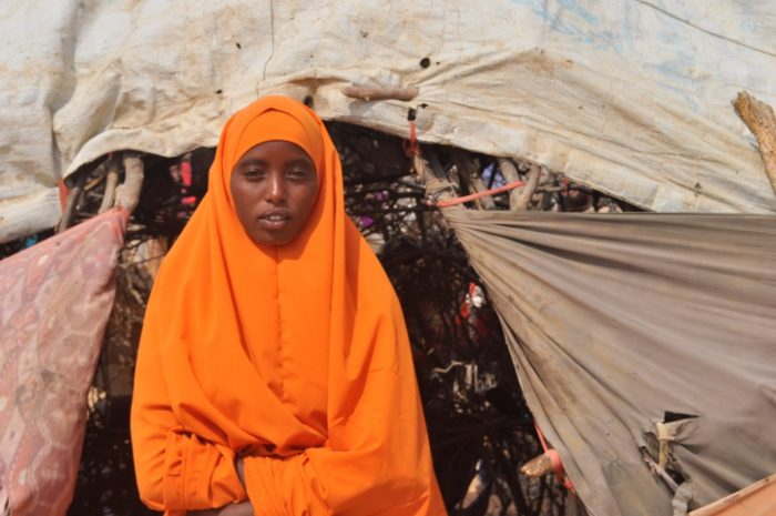 A girl stands outside her home in El Wak,  in southern Somalia. Many girls in the East African country leave school early and become child brides (Photo: Doreen Ajiambo/ARA Network).
