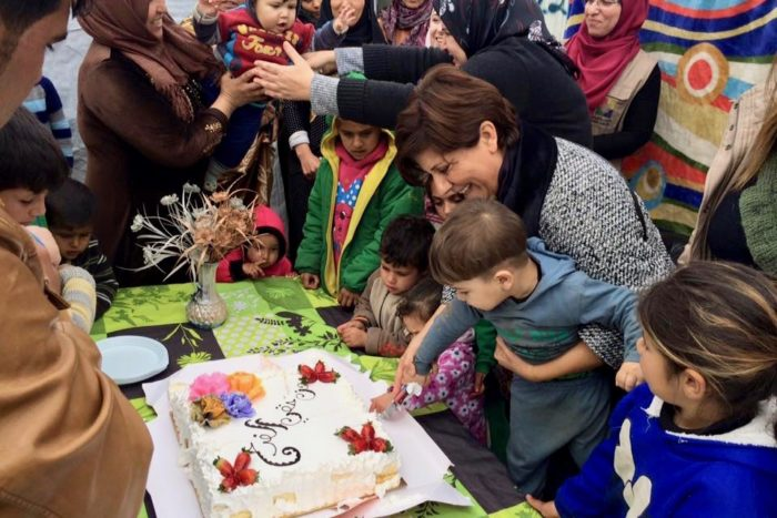 Families take part in a celebration honoring mothers in a refugee camp (Photo: Sawa Association for Development).