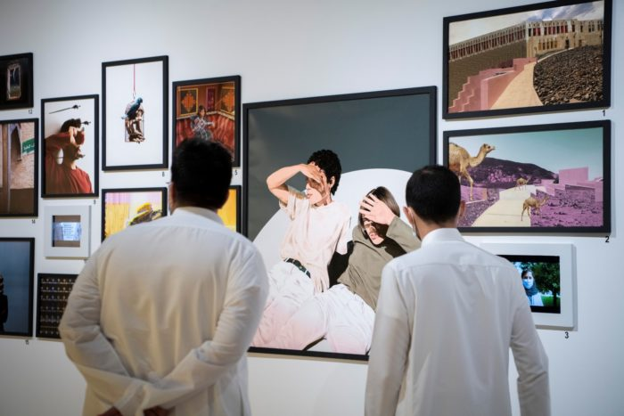 Visitors view works in an exhibition of photographs and digital art at the Misk Art Institute. The institute is a major supporter of creative arts in Saudi Arabia (Photo: Misk Art Institute).