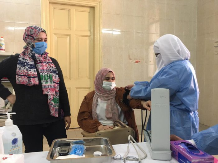 A female doctor gets a blood-pressure check after receiving a Covid-19 vaccination at an Egyptian Ministry of Health hospital in Assiut Governorate  (Photo: Tarek Abd Elgalil).