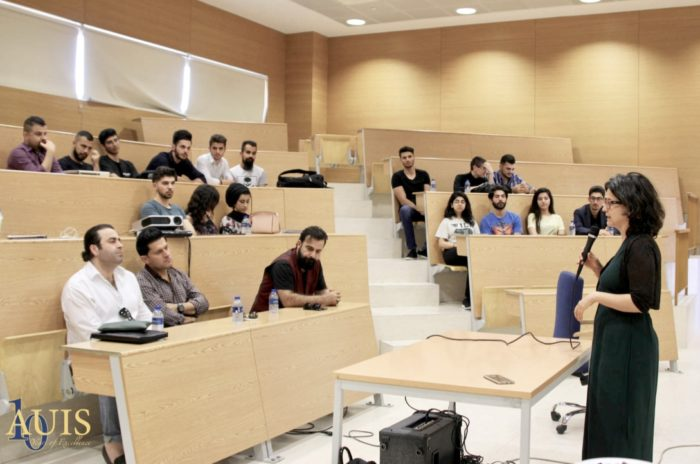 """Choman Hardi leads a discussion at the American University of Iraq, Sulaimani. Hardi returned to the region to teach in 2014 after 26 years abroad. """"I felt I could do a lot of good here,"""" she says (Photo: courtesy of Choman Hardi)"""