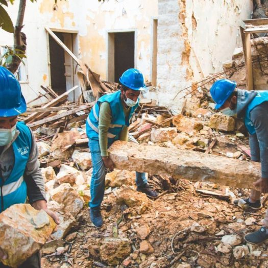 Removing debris from a damaged building (Photo courtesy of Live Love Beirut).