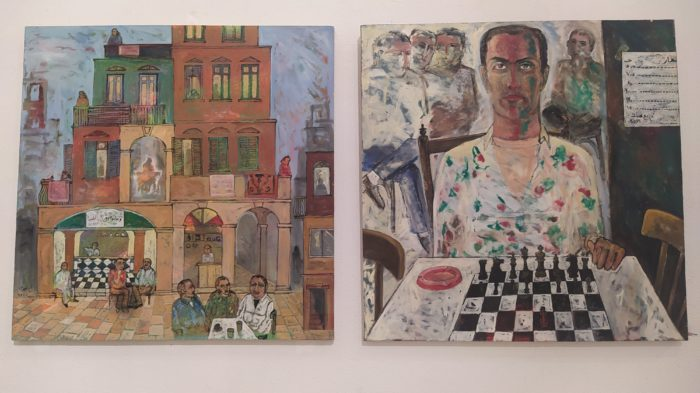 A cityscape and a portrait by the artist Omar El Fayoumi