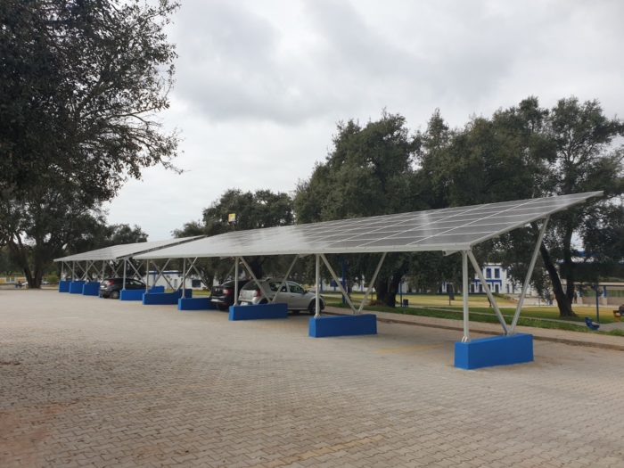 A canopy over a parking lot is covered with photovoltaic cells that help produce some of the university's power needs.