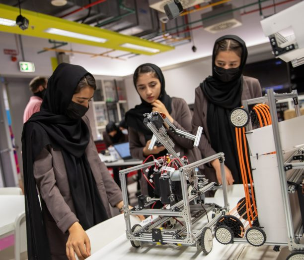 """Members of the team work on a project in Qatar. """"We continue our way, and nothing can stop us,"""" says Sumaya Faruqi, one of the nine in Qatar."""