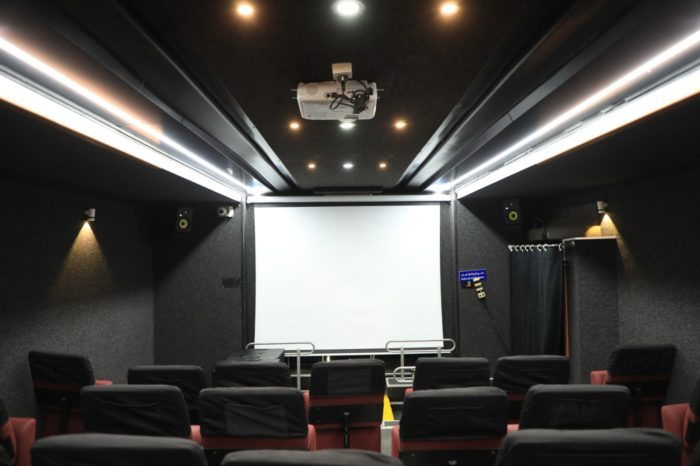 A screen for showing movies inside the bus. Its projectors run on solar power.