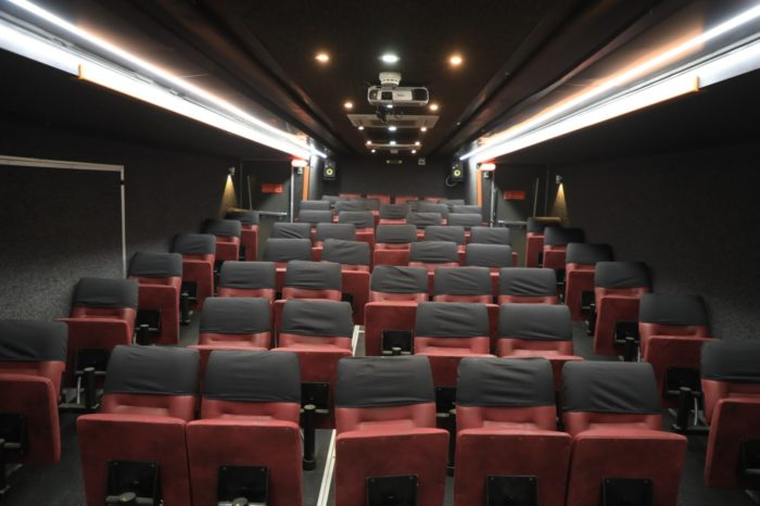 The bus has theater seating for about 50 people inside.