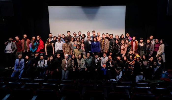 Students and professors at the Higher Institute of Dramatic Arts, in Damascus.