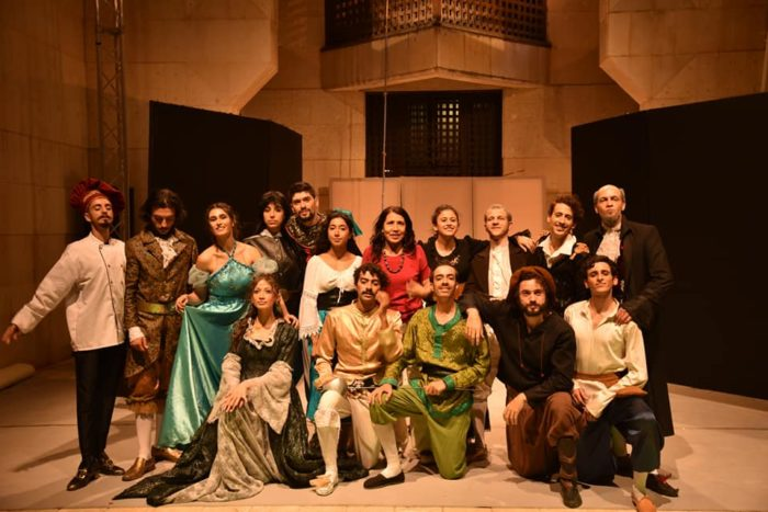 The cast assembles after a show at the Higher Institute of Dramatic Arts.