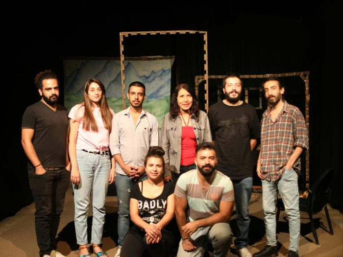 Cast and crew members on the set of a student production at the Higher Institute of Dramatic Arts, in Damascus.