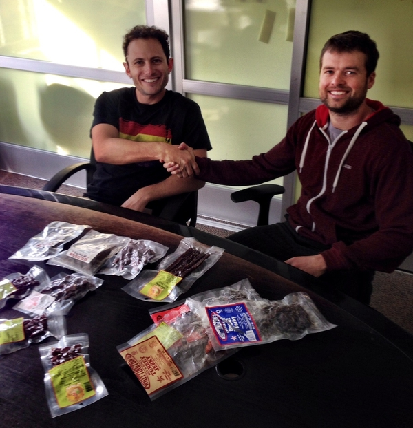 Ryan and I sealing the deal and eating jerky