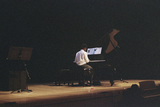 20150825125655-bakary_playing_piano_at_his_graduation__2015