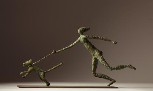 20160829162058-fletcher_hagar_running_with_a_dog__bronze_sculpture