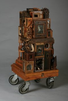 20170116204205-the_city_mixed_media_found_materials_wood_metal_box_structures_architectural_tower_sculpture_on_wheels_by_artist_wayne_chisnall