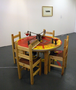 4__prototype_for_an_ideal__installation_shot_-_4_wooden_chairs_mechanised_table_paint__primary_colours__-_dimensions_variable_-_2008