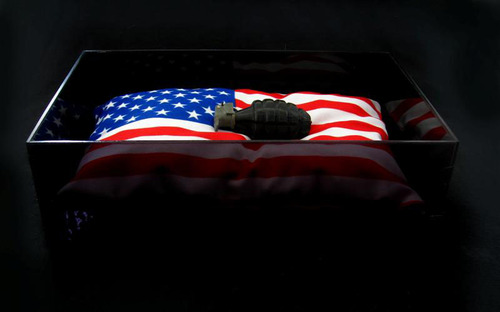 Hand_grenade_resting_on_flag_pillow