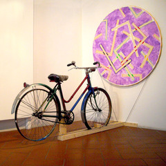 20101225081903-0007_bicycle_project___installation_view_ken_s_art_gallery_florence_2010__painting_diameter_55___acrylic_on_canvas__bicycle__wooden_construction_2010