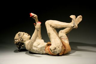20100916070234-writhing_woman_with_wrap_and_red_fingertips_r-l-_bob_clyatt_sculpture
