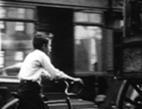 20110216035121-levitt_boy_on_bike_inthestreet_150w_000