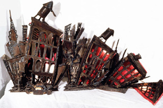 20110330200241-linus_coraggio__decline_of_the_east_village__1985__welded_steel_and_lights__16x15x24