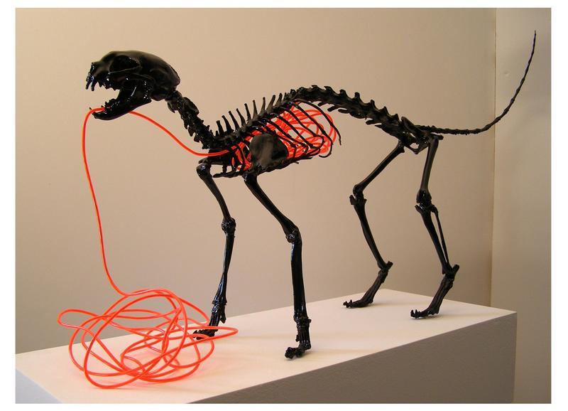 20110403202249-david_a_smith__banshee__2011__resin_feline_skeleton__el_wire__black_gloss_finish__46_x_60_x_20_cm