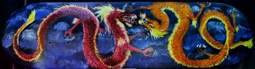 20110408141524-dueling_red___gold_dragons-2