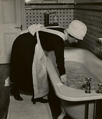 20130318224946-parlourmaid_preparing_a_bath_before_dinner_c__19370