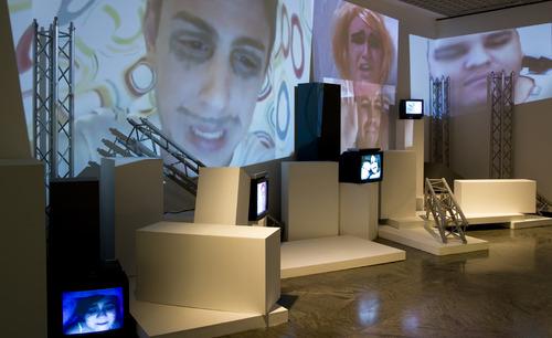 20131103174130-driant_zeneli_-_exhibition_view__leave_me_alone__2013__eight_channels_video_installation__colours__sound__courtesy_the_artistphoto_bruna_biamino