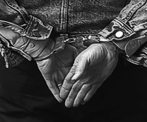 20160210133843-handcuffedrev-bwresizex