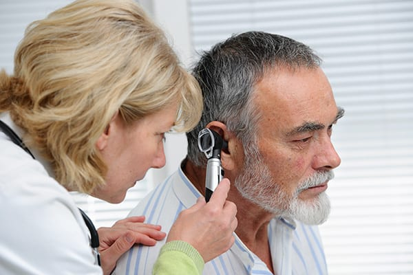 a man with hearing loss in an ear exam