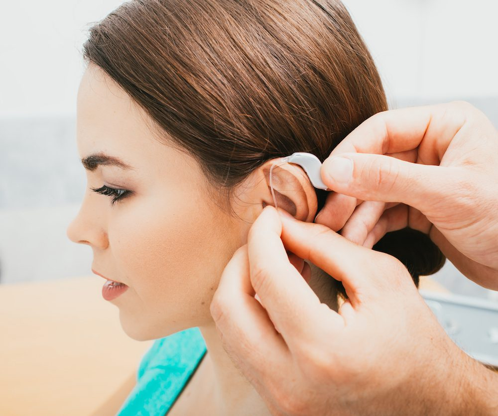 HIS fitting patient with white bte hearing aid